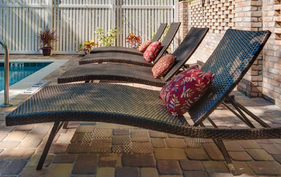 chaise lounge chairs by the outdoor pool