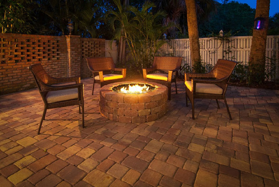 fire pit with chairs around at night