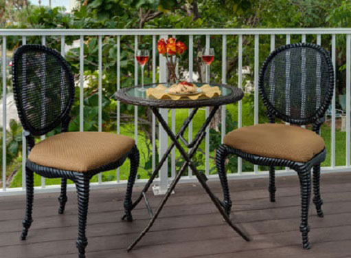 table with two chairs on the Sunset Suite deck
