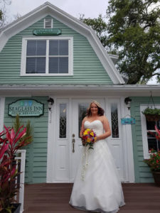 bride standing in front of the SeaGlass Inn Bed and Breakfast