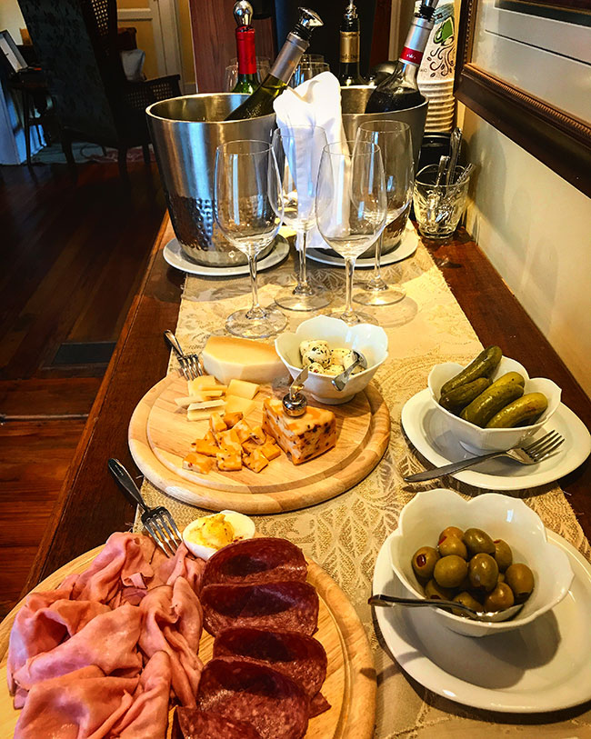 wine and cheese spread at happy hour